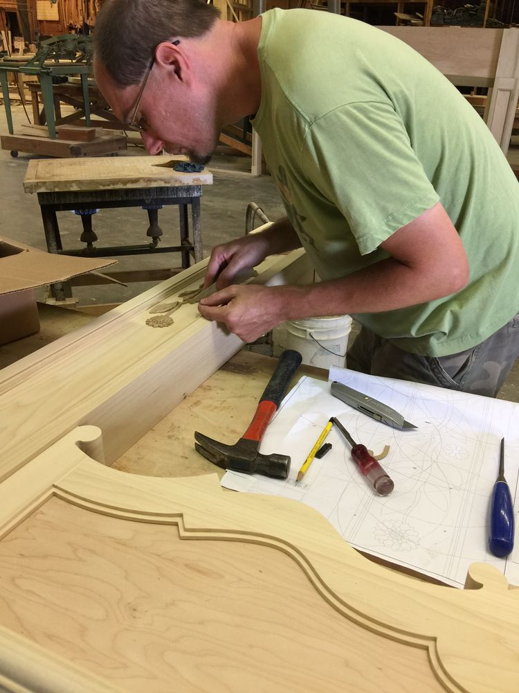 Working on the composition elements on the legs of the mantel