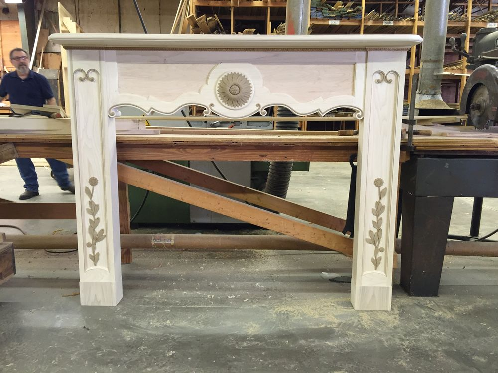 French style mantel with ogee curves and floral decoration applied to breast and legs