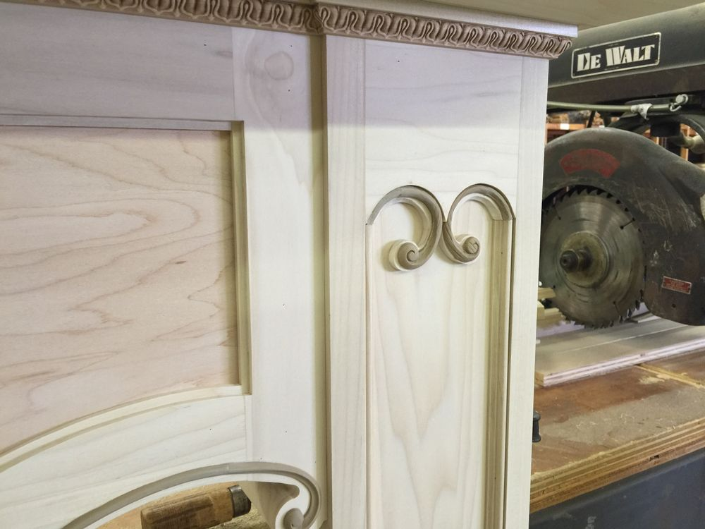 Curved detail on the top of the mantel legs
