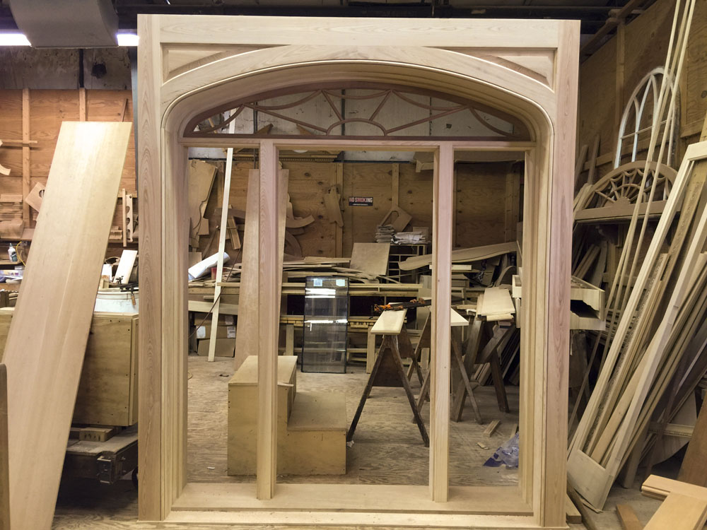 Mahogany custom entrance doorway with elliptical fanlight