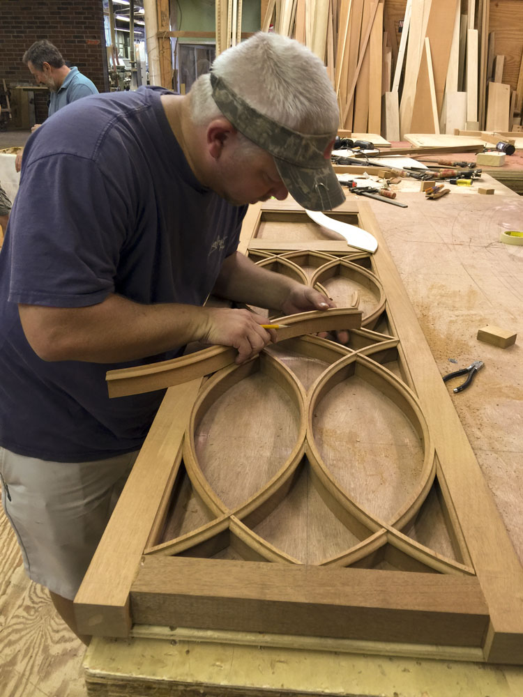 Driwood artisan creating true curved muntins for sidelights for mahogany entrance