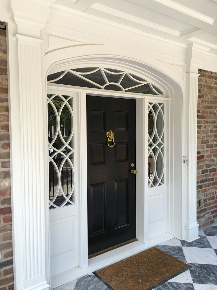 Georgan fanlight with sidelights in traditional Charleston home. Front installed closeup